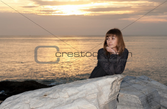 girl against the sea at night