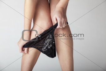 woman removing her undies