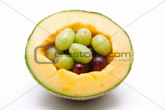 Half a melon with grapes
