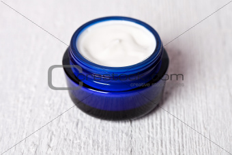 face cream in blue jar