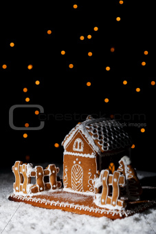 Gingerbread house under starry sky