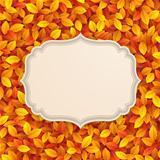 Vintage card on autumn leaves texture.