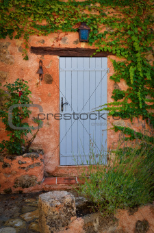 Old blue door in orange wall