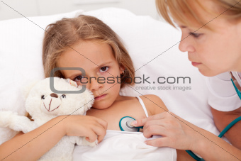 Health professional checking sick little girl
