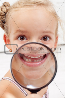 Little girl showing missing teeth