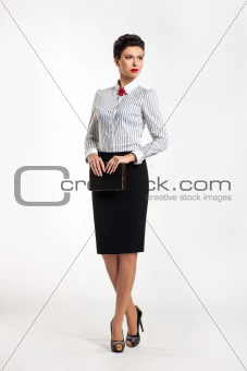 Confident entrepreneur woman in business suit in office