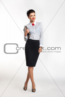Portrait of beautiful young businesswoman with notebook