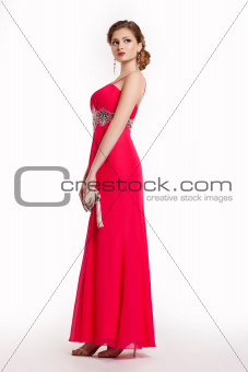 Fashion young woman in luxury red long dress with handbag