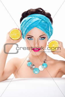 Smiling beautiful woman holding fresh lemon - wholesome food