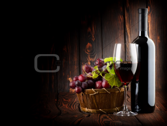 Wine on the dark wooden background