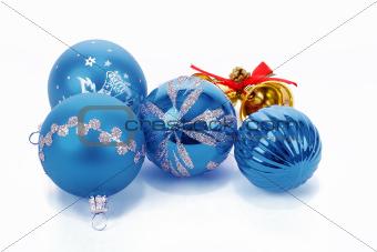 Blue christmas balls and small golden bells