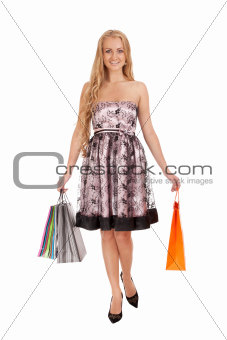 Beautiful blond woman holding shopping bags