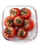 Baked stuffed tomatoes, over white