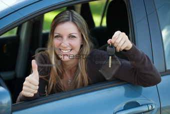 Happy driver with car key