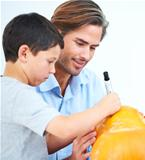 Making jack-o-lanterns with dad