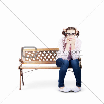 Portrait Of A Sad Lonely Woman Alone On Park Bench