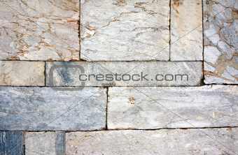 Wall of marble blocks