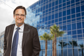 Handsome Businessman in Suit and Tie Smiling Outside of Corporate Building.