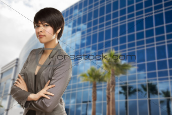 Attractive Mixed Race Young Adult in Front of Corporate Building.