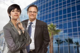 Attractive Mixed Race Woman and Businessman in Front of Corporate Building.