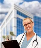 Attractive Friendly Female Blonde Doctor or Nurse in Front of Corporate Building.