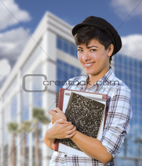 Attractive Mixed Race Female Student Holding Books in Front of Building.