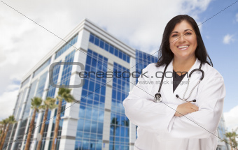 Attractive Hispanic Doctor or Nurse in Front of Corporate Building.