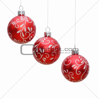 three isolated christmas balls