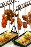 Two racks of tender and seasoned meat sitting side by side above beds of vegetables