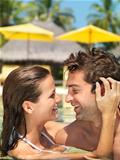 Romantic couple having fun in the pool