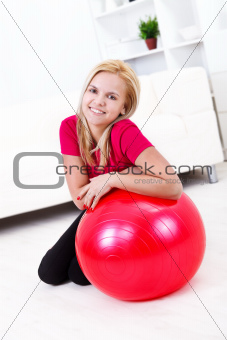 Girl and red fitness ball