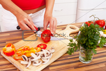 Hands of a woman cutting vegetables