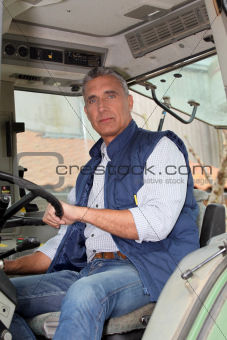 portrait of a farmer in tractor