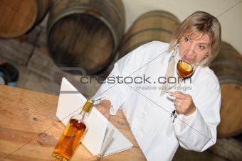 wine expert tasting wine in a cellar