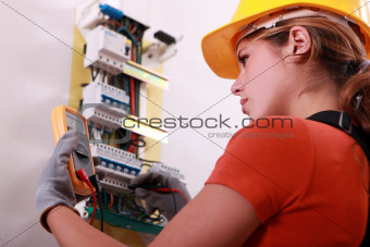 Woman measuring electrical current