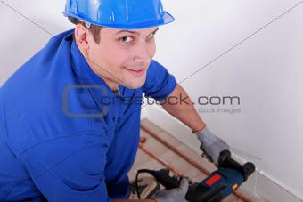 Plumber drilling