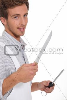 Butcher holding knifes