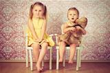 two sisters sitting on a chair