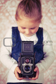 young girl with analogue camera