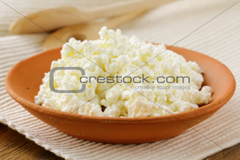 natural dairy product cottage cheese on a wooden table, rustic style