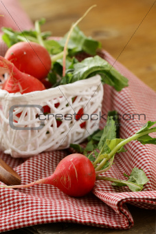 juicy organic radishes in a white basket