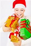 Happy Santa girl holding gifts