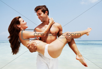 Romantic young couple enjoying their beach vacation