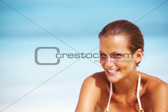 Closeup of charming young woman smiling - copyspace