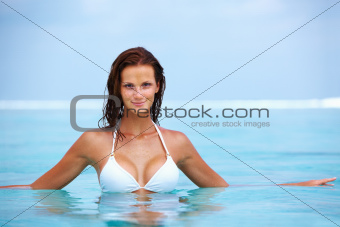 Portrait of glamorous young woman spending time in water
