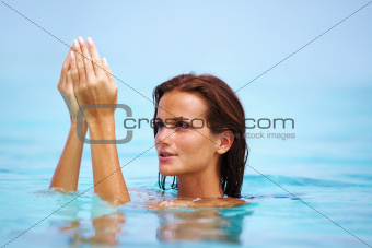 Portrait of elegant young woman relaxing at water