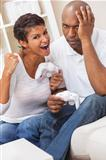 African American Couple Playing Video Console Game