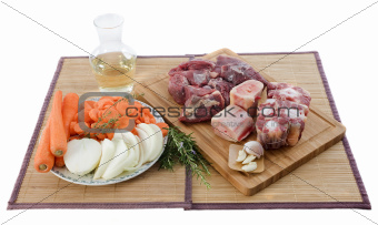 variety of meat, vegetables and wine