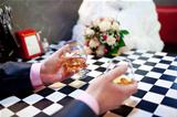 two glasses of cognac in the hands of male