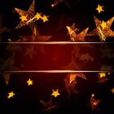 golden stars over dark red christmas background with text space
